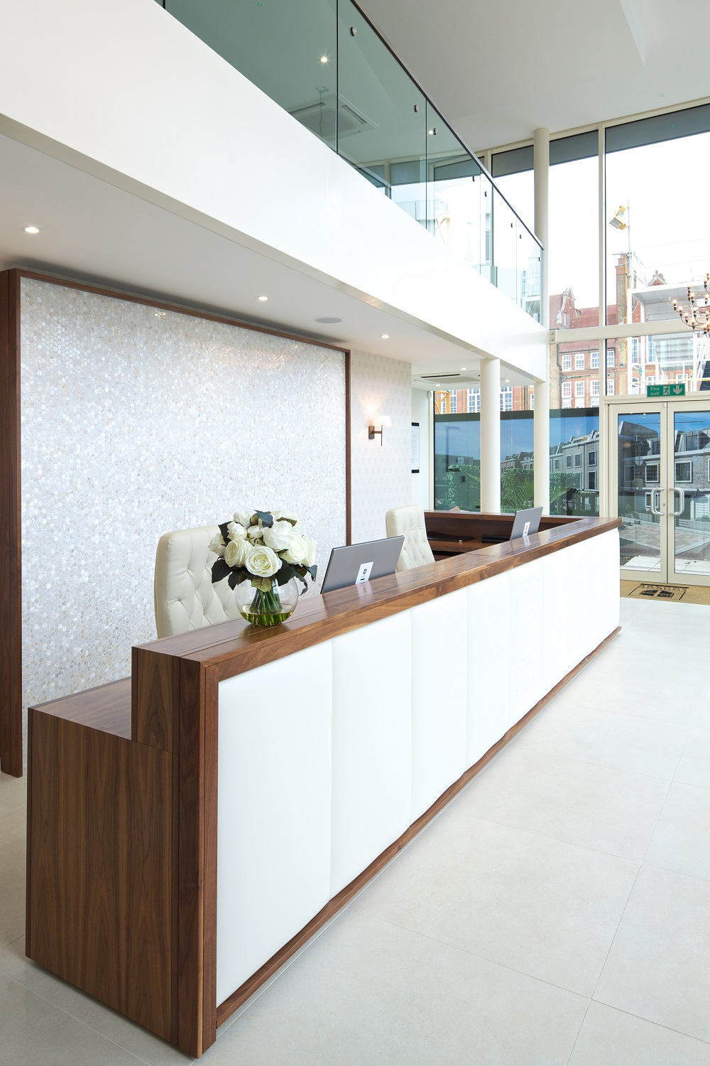 Reception Desk in Walnut with White Leather Upholstered Panels