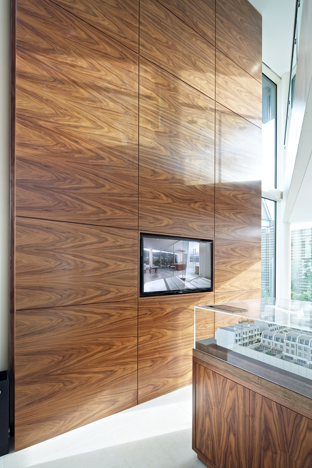 Seven Metre High Wall clad in Walnut Panelling