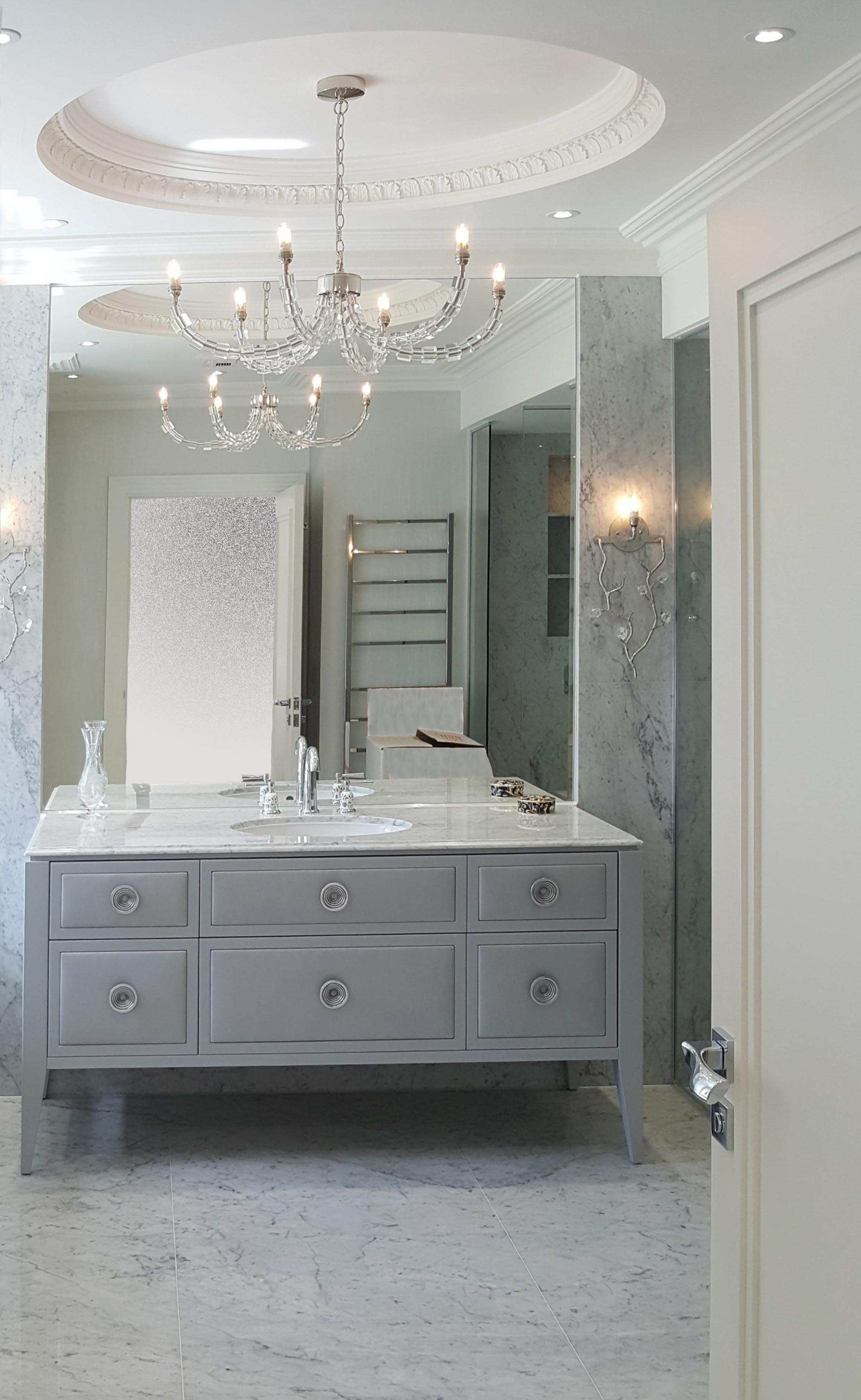 marble top vanity unit with drawers.