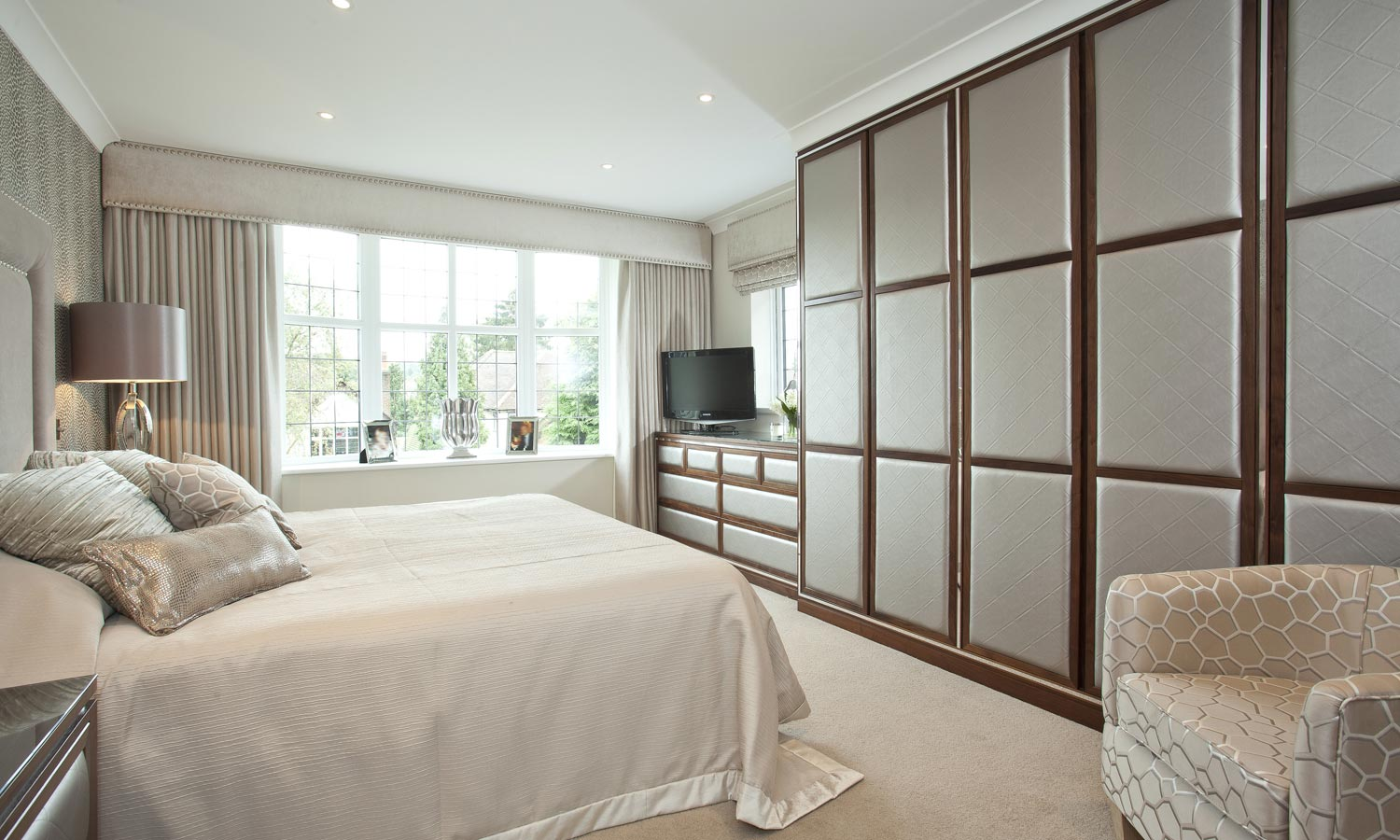Fitted Wardrobes with Upholstered Fabric Panels