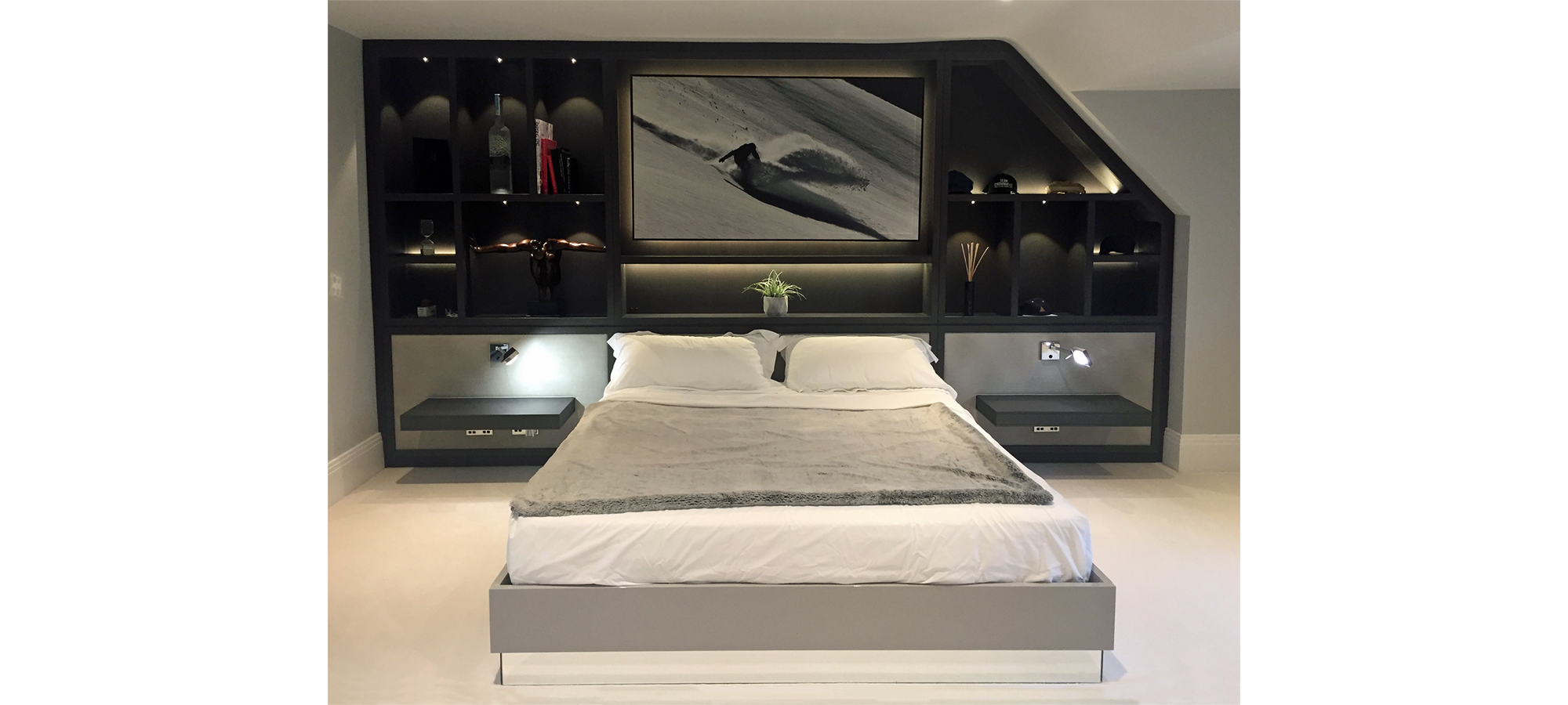 Fitted wall unit with integrated headboard
